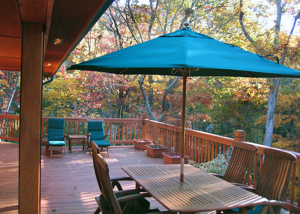 There are two decks that are 40 feet by 20 feet.  This upper one and one directly below this.  There is lighting in the posts around the deck as well as gas plumbed in several spots around the deck to attach a BBQ, gas fire pit or heaters.  There are also fans under the covered portion of the deck.