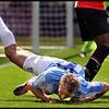 Feyenoord - Malaga ; Mokotjo heeft de Spaanse voetballer Monreal getorpedeerd die daarop met een blessure uitvalt<br /> Foto ; Jane Lasonder