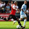 Feyenoord - Malaga ; Mokotjo zet met een gave techniek de bal voor tegen Malaga<br /> Foto ; Jane Lasonder