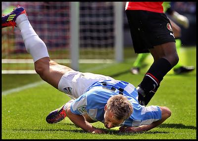 Feyenoord - Malaga ; Mokotjo heeft de Spaanse voetballer Monreal getorpedeerd die daarop met een blessure uitvalt Foto ; Jane Lasonder
