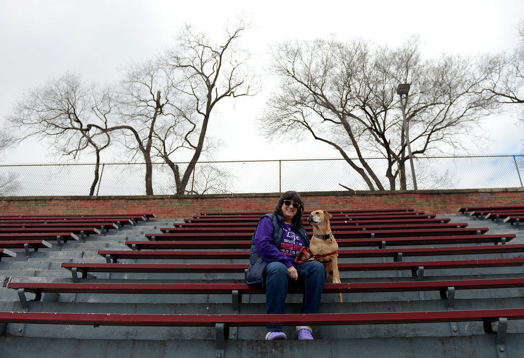 . Tania Barricklo-Daily Freeman  Janet Johnson Schliff sits in the bleachers at Dietz Stadium in Kingston, N.Y. with her dog Happy. Johnson Schliff spent twenty years from the early 1980\'s to the early 2000\'s working with the Special Olympics, half of it spent in Dutchess County and the other half in Ulster.