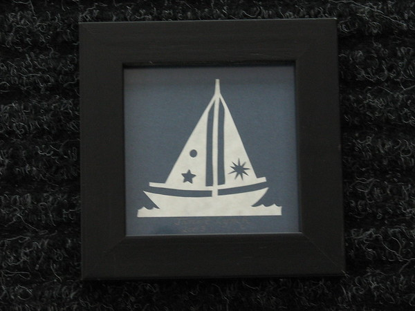 """Title: """"Sailboat"""" - Framed Hand Cut Parchment <br /> Janet's Original Design<br /> Size: 3x3<br /> Price:$6  Plus Tax -S&H<br /> Email Your Order: JanetLynchArt@gmail.com"""