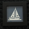 "Title: ""Sailboat"" - Framed Hand Cut Parchment <br /> Janet's Original Design<br /> Size: 3x3<br /> Price:$6  Plus Tax -S&H<br /> Email Your Order: JanetLynchArt@gmail.com"