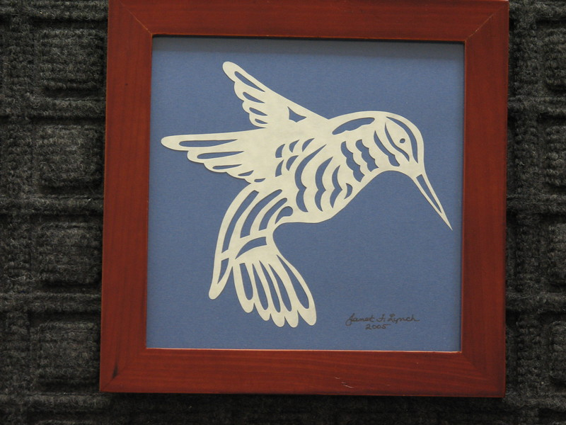 "Title: ""Humming Bird"" - Framed Hand Cut Parchment <br /> Size: 5.5x5.5<br /> Price:$15  Plus Tax -S&H<br /> Email Your Order: JanetLynchArt@gmail.com"