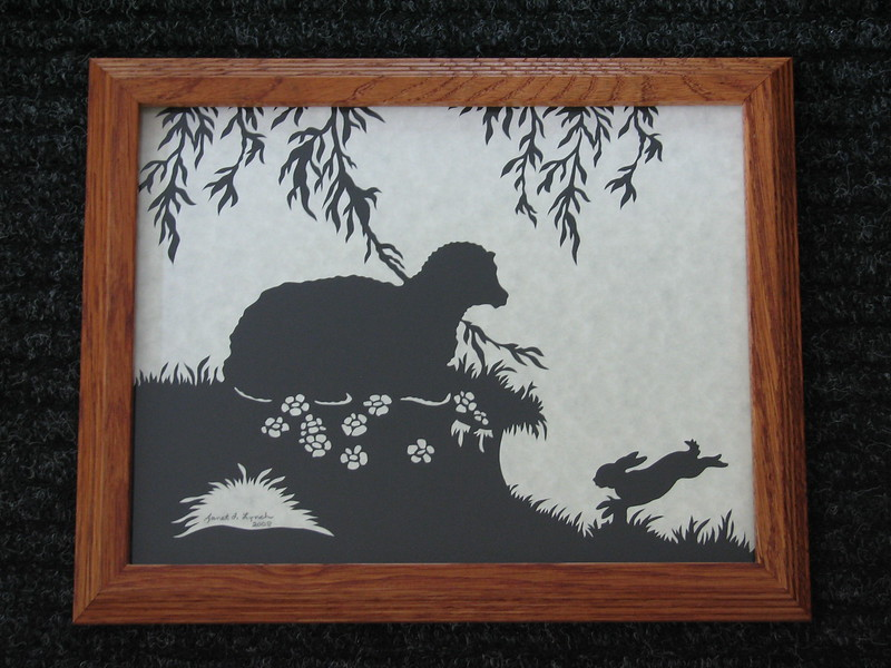 "Title: ""Sheep With Rabbit"" - Framed Hand Cut Parchment <br /> Size: 8.5x11<br /> Price:$55 Plus Tax -S&H<br /> Email Your Order: JanetLynchArt@gmail.com"