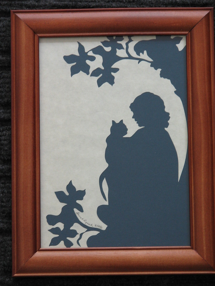 """Title: """"Girl Holding Cat"""" - Framed Hand Cut Parchment <br /> Size: 5x7<br /> Price:$12  Plus Tax -S&H<br /> Email Your Order: JanetLynchArt@gmail.com"""