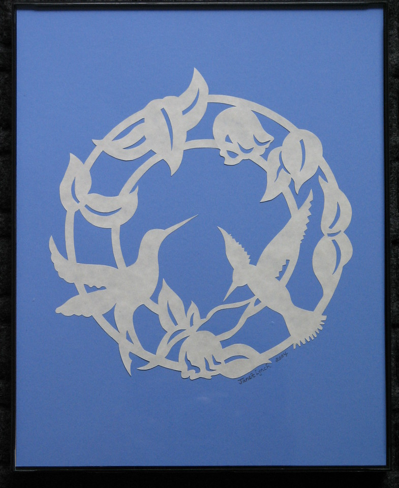 """Title: """"Humming Bird - Ring Of Flowers"""" - Framed Hand Cut Parchment <br /> Size: 8x10<br /> Price:$35 Plus Tax -S&H<br /> Email Your Order: JanetLynchArt@gmail.com"""
