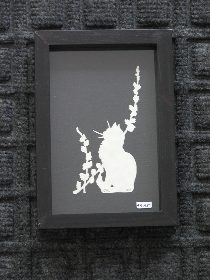 """Title: """"Cat Sitting With Flowers"""" - Framed Hand Cut Parchment <br /> Size: 3.5x5.5 <br /> Price:$10  Plus Tax -S&H<br /> Email Your Order: JanetLynchArt@gmail.com"""
