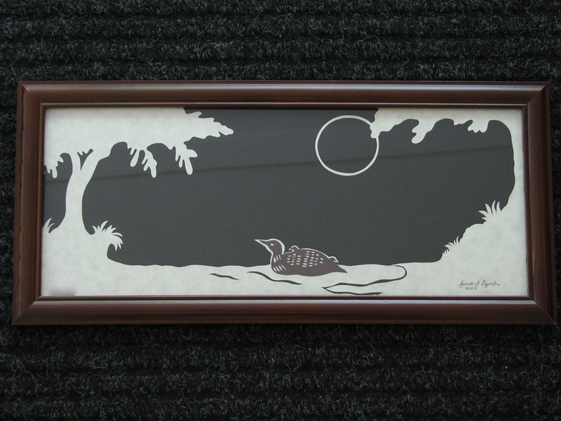 "Title: ""Loon With Babies"" - Framed Hand Cut Parchment <br /> Janet's Original Design<br /> Size: 6x14.5<br /> Price:$39  Plus Tax -S&H<br /> Email Your Order: JanetLynchArt@gmail.com"