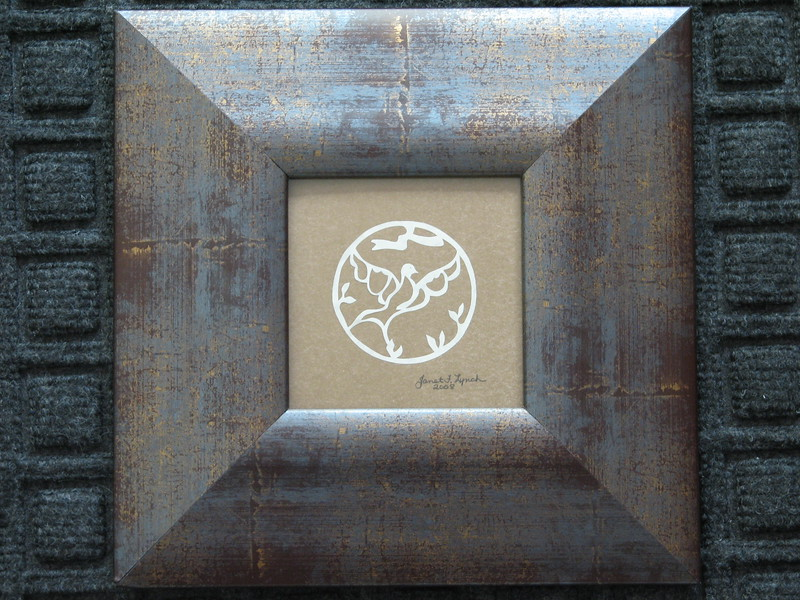 "Title: ""Dove In Circle"" - Framed Hand Cut Parchment <br /> Size: 3.5x3.5<br /> Price:$20  Plus Tax -S&H<br /> Email Your Order: JanetLynchArt@gmail.com"