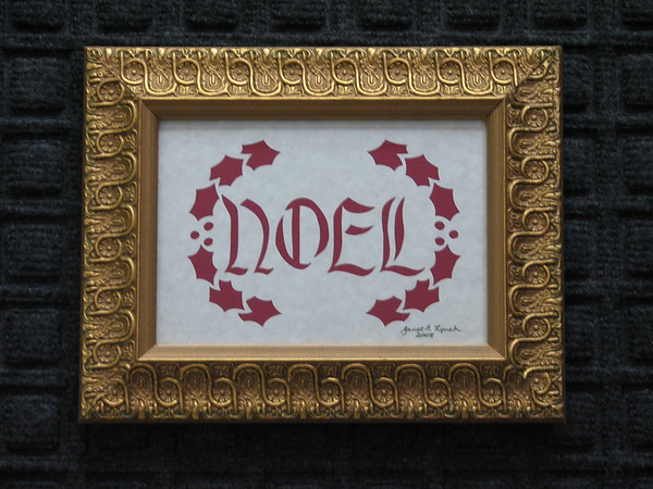 """Title: """"Noel And Holly"""" -Framed Hand Cut Parchment  <br /> Size: 5x7<br /> Price: $20 Plus Tax -S&H<br /> Email Your Order: JanetLynchArt@gmail.com"""