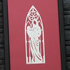 "Title: ""Mary With Jesus Stained Glass"" -Framed Hand Cut Parchment  <br /> Size: 5.5x11<br /> Price: $25 Plus Tax -S&H<br /> Email Your Order: JanetLynchArt@gmail.com"