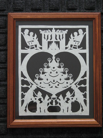 "Title: ""Family Christmas"" -Framed Hand Cut Parchment  <br /> Size: 8x10<br /> Price: $49 Plus Tax -S&H<br /> Buy This Item: <a href=""http://www.etsy.com/listing/86877304/christmas-framed-scherenschnitte-family"">http://www.etsy.com/listing/86877304/christmas-framed-scherenschnitte-family</a><br /> JanetLynchArt@gmail.com"