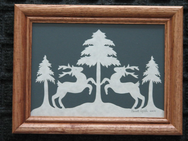 "Title: ""Deer At Evergreen Tree"" -Framed Hand Cut Parchment  <br /> Size: 5x7<br /> Price: $20 Plus Tax -S&H<br /> Email Your Order: JanetLynchArt@gmail.com"
