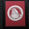 "Title: ""Santa Circle"" - Framed Hand Cut Parchment <br /> Size: 10x13<br /> Price:$35  Plus Tax -S&H<br /> Email Your Order: JanetLynchArt@gmail.com"