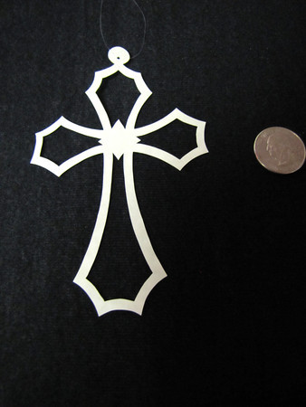 """Title: """" Cross """" - Hand Cut Parchment<br /> Price: $6<br /> This item ships free in U.S. and Canada when shipped with an equal or lesser item<br /> <br /> ~ Scherenschnitte (hand paper cutting) Christmas Ornament<br /> Signed and dated by Janet Lynch<br /> <br /> ~ All Christmas ornaments can be personalized with names in Calligraphy<br /> Water Mark will not appear on your art order<br /> <br /> ~Want this as a print on a 5x7 Note Card? <a href=""""http://www.etsy.com/listing/71810088/note-cards-5x7-choose-any-photo-or-paper"""">http://www.etsy.com/listing/71810088/note-cards-5x7-choose-any-photo-or-paper</a><br /> <br /> ~ Want this as a print on a jewelry pendant? <a href=""""http://www.etsy.com/listing/74448914/cape-hatteras-lighthouse-fine-art"""">http://www.etsy.com/listing/74448914/cape-hatteras-lighthouse-fine-art</a><br /> <br /> ~ Special Custom requests welcome.....just email me and I will do my best to work with you. If you have a theme or particular interest I am sure I have a design for you......or I will design one just for you.<br /> <br /> ~Visit our shop to see all my hand cut Scherenschnitte Art, Fine Art Photography, Prints, Christmas Ornaments, Bookmarks, Note Cards, Photo Pendants, Jewelry:<br /> <a href=""""http://artgalleryriverrd.etsy.com"""">http://artgalleryriverrd.etsy.com</a>"""