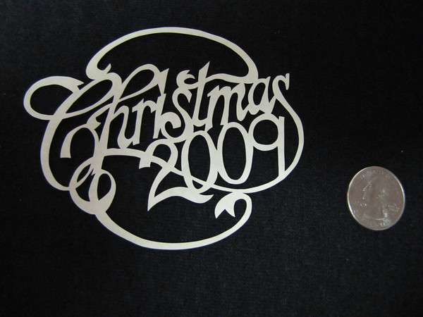 """Title: """"Your Year"""" - Hand Cut Parchment<br /> Price: $10<br /> This item ships free in U.S. and Canada when shipped with an equal or lesser item<br /> <br /> Buy This Item: <a href=""""http://www.etsy.com/listing/79688860/christmas-ornaments-scherenschnitte-hand"""">http://www.etsy.com/listing/79688860/christmas-ornaments-scherenschnitte-hand</a><br /> <br /> ~ Scherenschnitte (hand paper cutting) Christmas Ornament<br /> Signed and dated by Janet Lynch<br /> <br /> ~ All Christmas ornaments can be personalized with names in Calligraphy<br /> Water Mark will not appear on your art order<br /> <br /> ~Want this as a print on a 5x7 Note Card? <a href=""""http://www.etsy.com/listing/71810088/note-cards-5x7-choose-any-photo-or-paper"""">http://www.etsy.com/listing/71810088/note-cards-5x7-choose-any-photo-or-paper</a><br /> <br /> ~ Want this as a print on a jewelry pendant? <a href=""""http://www.etsy.com/listing/74448914/cape-hatteras-lighthouse-fine-art"""">http://www.etsy.com/listing/74448914/cape-hatteras-lighthouse-fine-art</a><br /> <br /> ~ Special Custom requests welcome.....just email me and I will do my best to work with you. If you have a theme or particular interest I am sure I have a design for you......or I will design one just for you."""