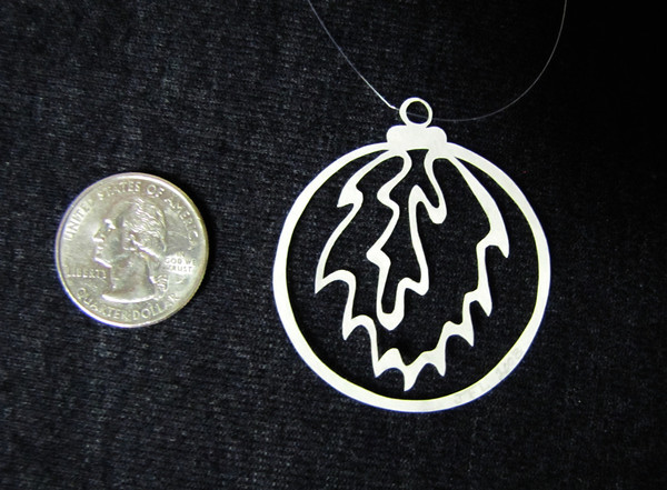 "Title: ""Small Christmas Ball "" - Hand Cut Parchment<br /> Price: $6<br /> This item ships free in U.S. and Canada when shipped with an equal or lesser item<br /> <br /> ~ Scherenschnitte (hand paper cutting) Christmas Ornament<br /> Signed and dated by Janet Lynch<br /> <br /> ~ All Christmas ornaments can be personalized with names in Calligraphy<br /> Water Mark will not appear on your art order<br /> <br /> ~Want this as a print on a 5x7 Note Card? <a href=""http://www.etsy.com/listing/71810088/note-cards-5x7-choose-any-photo-or-paper"">http://www.etsy.com/listing/71810088/note-cards-5x7-choose-any-photo-or-paper</a><br /> <br /> ~ Want this as a print on a jewelry pendant? <a href=""http://www.etsy.com/listing/74448914/cape-hatteras-lighthouse-fine-art"">http://www.etsy.com/listing/74448914/cape-hatteras-lighthouse-fine-art</a><br /> <br /> ~ Special Custom requests welcome.....just email me and I will do my best to work with you. If you have a theme or particular interest I am sure I have a design for you......or I will design one just for you.<br /> <br /> ~Visit our shop to see all my hand cut Scherenschnitte Art, Fine Art Photography, Prints, Christmas Ornaments, Bookmarks, Note Cards, Photo Pendants, Jewelry:<br /> <a href=""http://artgalleryriverrd.etsy.com"">http://artgalleryriverrd.etsy.com</a>"