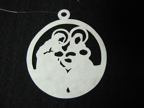 """Title: """"Nativity"""" - Hand Cut Parchment<br /> Price: $6<br /> This item ships free in U.S. and Canada when shipped with an equal or lesser item<br /> <br /> ~ Scherenschnitte (hand paper cutting) Christmas Ornament<br /> Signed and dated by Janet Lynch<br /> <br /> ~ All Christmas ornaments can be personalized with names in Calligraphy<br /> Water Mark will not appear on your art order<br /> <br /> ~Want this as a print on a 5x7 Note Card? <a href=""""http://www.etsy.com/listing/71810088/note-cards-5x7-choose-any-photo-or-paper"""">http://www.etsy.com/listing/71810088/note-cards-5x7-choose-any-photo-or-paper</a><br /> <br /> ~ Want this as a print on a jewelry pendant? <a href=""""http://www.etsy.com/listing/74448914/cape-hatteras-lighthouse-fine-art"""">http://www.etsy.com/listing/74448914/cape-hatteras-lighthouse-fine-art</a><br /> <br /> ~ Special Custom requests welcome.....just email me and I will do my best to work with you. If you have a theme or particular interest I am sure I have a design for you......or I will design one just for you.<br /> <br /> ~Visit our shop to see all my hand cut Scherenschnitte Art, Fine Art Photography, Prints, Christmas Ornaments, Bookmarks, Note Cards, Photo Pendants, Jewelry:<br /> <a href=""""http://artgalleryriverrd.etsy.com"""">http://artgalleryriverrd.etsy.com</a>"""