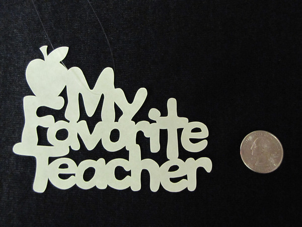 "Title: ""My Favorite Teacher"" - Hand Cut Parchment<br /> Price: $6<br /> This item ships free in U.S. and Canada when shipped with an equal or lesser item<br /> <br /> ~ Scherenschnitte (hand paper cutting) Christmas Ornament<br /> Signed and dated by Janet Lynch<br /> <br /> ~ All Christmas ornaments can be personalized with names in Calligraphy<br /> Water Mark will not appear on your art order<br /> <br /> ~Want this as a print on a 5x7 Note Card? <a href=""http://www.etsy.com/listing/71810088/note-cards-5x7-choose-any-photo-or-paper"">http://www.etsy.com/listing/71810088/note-cards-5x7-choose-any-photo-or-paper</a><br /> <br /> ~ Want this as a print on a jewelry pendant? <a href=""http://www.etsy.com/listing/74448914/cape-hatteras-lighthouse-fine-art"">http://www.etsy.com/listing/74448914/cape-hatteras-lighthouse-fine-art</a><br /> <br /> ~ Special Custom requests welcome.....just email me and I will do my best to work with you. If you have a theme or particular interest I am sure I have a design for you......or I will design one just for you.<br /> <br /> ~Visit our shop to see all my hand cut Scherenschnitte Art, Fine Art Photography, Prints, Christmas Ornaments, Bookmarks, Note Cards, Photo Pendants, Jewelry:<br /> <a href=""http://artgalleryriverrd.etsy.com"">http://artgalleryriverrd.etsy.com</a>"