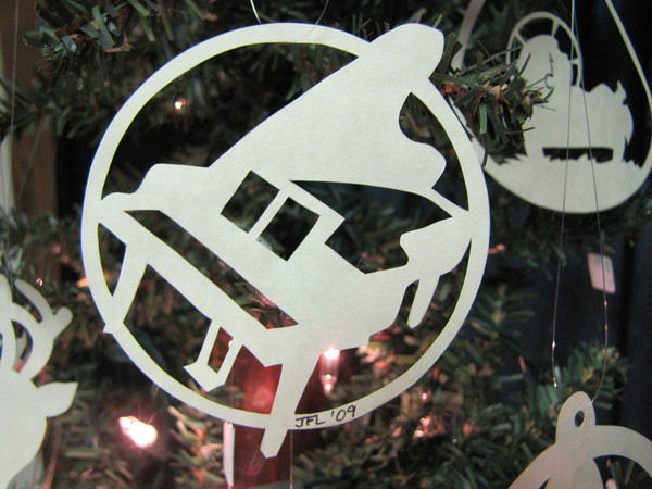 """Title: """" Piano """" - Hand Cut Parchment<br /> Price: $6<br /> This item ships free in U.S. and Canada when shipped with an equal or lesser item<br /> <br /> ~ Scherenschnitte (hand paper cutting) Christmas Ornament<br /> Signed and dated by Janet Lynch<br /> <br /> ~ All Christmas ornaments can be personalized with names in Calligraphy<br /> Water Mark will not appear on your art order<br /> <br /> ~Want this as a print on a 5x7 Note Card? <a href=""""http://www.etsy.com/listing/71810088/note-cards-5x7-choose-any-photo-or-paper"""">http://www.etsy.com/listing/71810088/note-cards-5x7-choose-any-photo-or-paper</a><br /> <br /> ~ Want this as a print on a jewelry pendant? <a href=""""http://www.etsy.com/listing/74448914/cape-hatteras-lighthouse-fine-art"""">http://www.etsy.com/listing/74448914/cape-hatteras-lighthouse-fine-art</a><br /> <br /> ~ Special Custom requests welcome.....just email me and I will do my best to work with you. If you have a theme or particular interest I am sure I have a design for you......or I will design one just for you.<br /> <br /> ~Visit our shop to see all my hand cut Scherenschnitte Art, Fine Art Photography, Prints, Christmas Ornaments, Bookmarks, Note Cards, Photo Pendants, Jewelry:<br /> <a href=""""http://artgalleryriverrd.etsy.com"""">http://artgalleryriverrd.etsy.com</a>"""