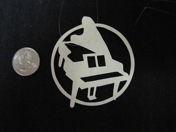 "Title: "" Piano "" - Hand Cut Parchment<br /> Price: $6<br /> This item ships free in U.S. and Canada when shipped with an equal or lesser item<br /> <br /> ~ Scherenschnitte (hand paper cutting) Christmas Ornament<br /> Signed and dated by Janet Lynch<br /> <br /> ~ All Christmas ornaments can be personalized with names in Calligraphy<br /> Water Mark will not appear on your art order<br /> <br /> ~Want this as a print on a 5x7 Note Card? <a href=""http://www.etsy.com/listing/71810088/note-cards-5x7-choose-any-photo-or-paper"">http://www.etsy.com/listing/71810088/note-cards-5x7-choose-any-photo-or-paper</a><br /> <br /> ~ Want this as a print on a jewelry pendant? <a href=""http://www.etsy.com/listing/74448914/cape-hatteras-lighthouse-fine-art"">http://www.etsy.com/listing/74448914/cape-hatteras-lighthouse-fine-art</a><br /> <br /> ~ Special Custom requests welcome.....just email me and I will do my best to work with you. If you have a theme or particular interest I am sure I have a design for you......or I will design one just for you.<br /> <br /> ~Visit our shop to see all my hand cut Scherenschnitte Art, Fine Art Photography, Prints, Christmas Ornaments, Bookmarks, Note Cards, Photo Pendants, Jewelry:<br /> <a href=""http://artgalleryriverrd.etsy.com"">http://artgalleryriverrd.etsy.com</a>"