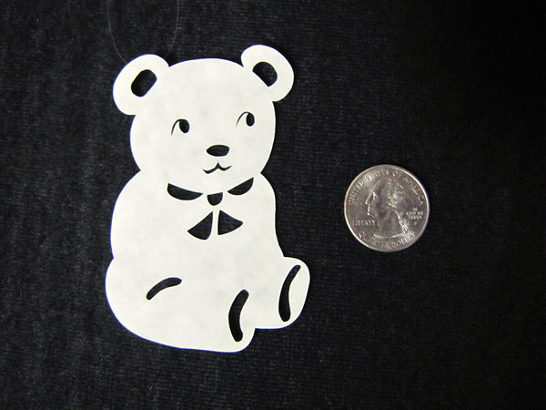 "Title: ""Teddy Bear "" - Hand Cut Parchment<br /> Price: $6<br /> This item ships free in U.S. and Canada when shipped with an equal or lesser item<br /> <br /> ~ Scherenschnitte (hand paper cutting) Christmas Ornament<br /> Signed and dated by Janet Lynch<br /> <br /> ~ All Christmas ornaments can be personalized with names in Calligraphy<br /> Water Mark will not appear on your art order<br /> <br /> ~Want this as a print on a 5x7 Note Card? <a href=""http://www.etsy.com/listing/71810088/note-cards-5x7-choose-any-photo-or-paper"">http://www.etsy.com/listing/71810088/note-cards-5x7-choose-any-photo-or-paper</a><br /> <br /> ~ Want this as a print on a jewelry pendant? <a href=""http://www.etsy.com/listing/74448914/cape-hatteras-lighthouse-fine-art"">http://www.etsy.com/listing/74448914/cape-hatteras-lighthouse-fine-art</a><br /> <br /> ~ Special Custom requests welcome.....just email me and I will do my best to work with you. If you have a theme or particular interest I am sure I have a design for you......or I will design one just for you.<br /> <br /> ~Visit our shop to see all my hand cut Scherenschnitte Art, Fine Art Photography, Prints, Christmas Ornaments, Bookmarks, Note Cards, Photo Pendants, Jewelry:<br /> <a href=""http://artgalleryriverrd.etsy.com"">http://artgalleryriverrd.etsy.com</a>"