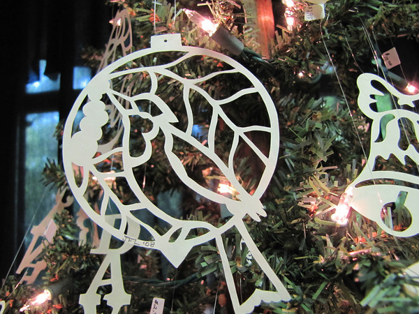 "Title: "" Bird and Berries "" - Hand Cut Parchment<br /> Price: $10<br /> This item ships free in U.S. and Canada when shipped with an equal or lesser item<br /> <br /> ~ Scherenschnitte (hand paper cutting) Christmas Ornament<br /> Signed and dated by Janet Lynch<br /> <br /> ~ All Christmas ornaments can be personalized with names in Calligraphy<br /> Water Mark will not appear on your art order<br /> <br /> ~Want this as a print on a 5x7 Note Card? <a href=""http://www.etsy.com/listing/71810088/note-cards-5x7-choose-any-photo-or-paper"">http://www.etsy.com/listing/71810088/note-cards-5x7-choose-any-photo-or-paper</a><br /> <br /> ~ Want this as a print on a jewelry pendant? <a href=""http://www.etsy.com/listing/74448914/cape-hatteras-lighthouse-fine-art"">http://www.etsy.com/listing/74448914/cape-hatteras-lighthouse-fine-art</a><br /> <br /> ~ Special Custom requests welcome.....just email me and I will do my best to work with you. If you have a theme or particular interest I am sure I have a design for you......or I will design one just for you.<br /> <br /> ~Visit our shop to see all my hand cut Scherenschnitte Art, Fine Art Photography, Prints, Christmas Ornaments, Bookmarks, Note Cards, Photo Pendants, Jewelry:<br /> <a href=""http://artgalleryriverrd.etsy.com"">http://artgalleryriverrd.etsy.com</a>"