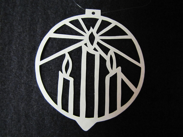 """Title: """"Two Candles """" - Hand Cut Parchment<br /> Price: $10<br /> This item ships free in U.S. and Canada when shipped with an equal or lesser item<br /> <br /> ~ Scherenschnitte (hand paper cutting) Christmas Ornament<br /> Signed and dated by Janet Lynch<br /> <br /> ~ All Christmas ornaments can be personalized with names in Calligraphy<br /> Water Mark will not appear on your art order<br /> <br /> ~Want this as a print on a 5x7 Note Card? <a href=""""http://www.etsy.com/listing/71810088/note-cards-5x7-choose-any-photo-or-paper"""">http://www.etsy.com/listing/71810088/note-cards-5x7-choose-any-photo-or-paper</a><br /> <br /> ~ Want this as a print on a jewelry pendant? <a href=""""http://www.etsy.com/listing/74448914/cape-hatteras-lighthouse-fine-art"""">http://www.etsy.com/listing/74448914/cape-hatteras-lighthouse-fine-art</a><br /> <br /> ~ Special Custom requests welcome.....just email me and I will do my best to work with you. If you have a theme or particular interest I am sure I have a design for you......or I will design one just for you.<br /> <br /> ~Visit our shop to see all my hand cut Scherenschnitte Art, Fine Art Photography, Prints, Christmas Ornaments, Bookmarks, Note Cards, Photo Pendants, Jewelry:<br /> <a href=""""http://artgalleryriverrd.etsy.com"""">http://artgalleryriverrd.etsy.com</a>"""