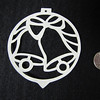 "Title: ""Silver Bells "" - Hand Cut Parchment<br /> Price: $10<br /> This item ships free in U.S. and Canada when shipped with an equal or lesser item<br /> <br /> ~ Scherenschnitte (hand paper cutting) Christmas Ornament<br /> Signed and dated by Janet Lynch<br /> <br /> ~ All Christmas ornaments can be personalized with names in Calligraphy<br /> Water Mark will not appear on your art order<br /> <br /> ~Want this as a print on a 5x7 Note Card? <a href=""http://www.etsy.com/listing/71810088/note-cards-5x7-choose-any-photo-or-paper"">http://www.etsy.com/listing/71810088/note-cards-5x7-choose-any-photo-or-paper</a><br /> <br /> ~ Want this as a print on a jewelry pendant? <a href=""http://www.etsy.com/listing/74448914/cape-hatteras-lighthouse-fine-art"">http://www.etsy.com/listing/74448914/cape-hatteras-lighthouse-fine-art</a><br /> <br /> ~ Special Custom requests welcome.....just email me and I will do my best to work with you. If you have a theme or particular interest I am sure I have a design for you......or I will design one just for you.<br /> <br /> ~Visit our shop to see all my hand cut Scherenschnitte Art, Fine Art Photography, Prints, Christmas Ornaments, Bookmarks, Note Cards, Photo Pendants, Jewelry:<br /> <a href=""http://artgalleryriverrd.etsy.com"">http://artgalleryriverrd.etsy.com</a>"