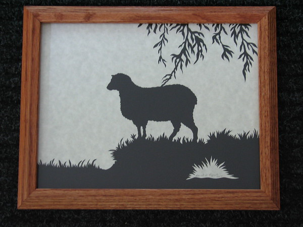 "Title: ""Sheep Standing"" - Framed Hand Cut Parchment <br /> Size: 8.5x11<br /> Price:$55 Plus Tax -S&H<br /> Email Your Order: JanetLynchArt@gmail.com"
