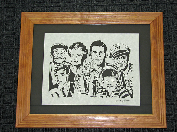 "Title: ""Andy Griffith Cast "" - Framed Hand Cut Parchment <br /> Size: 11x14  Difficulty 9 of 10<br /> Price:$135 Plus Tax -S&H<br /> Buy: <a href=""http://www.etsy.com/listing/41922193/andy-griffith-cast-scherenschnitte-hand"">http://www.etsy.com/listing/41922193/andy-griffith-cast-scherenschnitte-hand</a><br /> <br /> From our ""Most Popular"" list in our Art Gallery Located In Manakin Sabot, VA<br /> Scherenschnitte (hand paper cutting)<br /> Signed and dated by Janet Lynch framed 11x14<br /> Water Mark will not appear on your art order<br /> <br /> ~Want this as a print on a 5x7 Note card? <a href=""http://www.etsy.com/listing/71810088/note-cards-5x7-choose-any-photo-or-paper"">http://www.etsy.com/listing/71810088/note-cards-5x7-choose-any-photo-or-paper</a><br /> <br /> ~ Want this as a print on a jewelry pendant? <a href=""http://www.etsy.com/listing/74448914/cape-hatteras-lighthouse-fine-art"">http://www.etsy.com/listing/74448914/cape-hatteras-lighthouse-fine-art</a><br /> <br /> ~THIS ITEM SHIPS FREE IN US AND CANADA IF SHIPPED WITH ANY OTHER PURCHASE<br /> <br /> ~Have a special size or request? Just CLICK CONTACT AT THE BOTTOM and we'll see what we can work out.<br /> <br /> <br /> All images are copyright protected and the exclusive property of Janet Lynch and may not be used<br /> without permission."