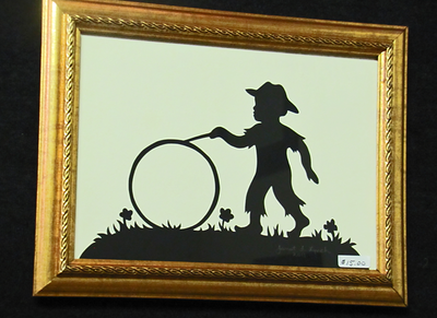"Title: "" Boy With Wheel "" - Framed Hand Cut Parchment<br /> Size: 5x7<br /> Difficulty 5 of 10<br /> Price:$15 Plus Tax -S&H<br /> <br /> Buy This Item: <a href=""http://www.etsy.com/listing/86284763/boy-with-wheel-scherenschnitte-hand"">http://www.etsy.com/listing/86284763/boy-with-wheel-scherenschnitte-hand</a><br /> <br /> Scherenschnitte (hand paper cutting)<br /> Signed and dated by Janet Lynch framed 5x7<br /> Water Mark will not appear on your art order<br /> <br /> ~Want this as a print on a 5x7 Note Card? <a href=""http://www.etsy.com/listing/71810088/note-cards-5x7-choose-any-photo-or-paper"">http://www.etsy.com/listing/71810088/note-cards-5x7-choose-any-photo-or-paper</a><br /> <br /> ~ Want this as a print on a jewelry pendant? <a href=""http://www.etsy.com/listing/74448914/cape-hatteras-lighthouse-fine-art"">http://www.etsy.com/listing/74448914/cape-hatteras-lighthouse-fine-art</a><br /> <br /> ~ Special Custom requests welcome.....just CLICK CONTACT AT THE BOTTOM  and I will do my best to work with you. If you have a theme or particular interest I am sure I have a design for you......or I will design one just for you."