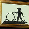 """Title: """" Boy With Wheel """" - Framed Hand Cut Parchment<br /> Size: 5x7<br /> Difficulty 5 of 10<br /> Price:$15 Plus Tax -S&H<br /> <br /> Buy This Item: <a href=""""http://www.etsy.com/listing/86284763/boy-with-wheel-scherenschnitte-hand"""">http://www.etsy.com/listing/86284763/boy-with-wheel-scherenschnitte-hand</a><br /> <br /> Scherenschnitte (hand paper cutting)<br /> Signed and dated by Janet Lynch framed 5x7<br /> Water Mark will not appear on your art order<br /> <br /> ~Want this as a print on a 5x7 Note Card? <a href=""""http://www.etsy.com/listing/71810088/note-cards-5x7-choose-any-photo-or-paper"""">http://www.etsy.com/listing/71810088/note-cards-5x7-choose-any-photo-or-paper</a><br /> <br /> ~ Want this as a print on a jewelry pendant? <a href=""""http://www.etsy.com/listing/74448914/cape-hatteras-lighthouse-fine-art"""">http://www.etsy.com/listing/74448914/cape-hatteras-lighthouse-fine-art</a><br /> <br /> ~ Special Custom requests welcome.....just CLICK CONTACT AT THE BOTTOM  and I will do my best to work with you. If you have a theme or particular interest I am sure I have a design for you......or I will design one just for you."""