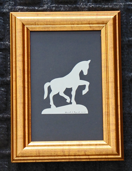 """Title: """" Horse """" - Framed Hand Cut Parchment<br /> Size: 4x6<br /> Difficulty 2 of 10<br /> Price: $7.00<br /> <br /> Buy This Item: <a href=""""http://www.etsy.com/listing/86284050/horse-scherenschnitte-hand-paper-cutting?ref=v1_other_2"""">http://www.etsy.com/listing/86284050/horse-scherenschnitte-hand-paper-cutting?ref=v1_other_2</a><br /> <br /> Scherenschnitte (hand paper cutting)<br /> Signed and dated by Janet Lynch framed 4x6<br /> Water Mark will not appear on your art order<br /> <br /> ~Want this as a print on a 5x7 Note Card? <a href=""""http://www.etsy.com/listing/71810088/note-cards-5x7-choose-any-photo-or-paper"""">http://www.etsy.com/listing/71810088/note-cards-5x7-choose-any-photo-or-paper</a><br /> <br /> ~ Want this as a print on a jewelry pendant? <a href=""""http://www.etsy.com/listing/74448914/cape-hatteras-lighthouse-fine-art"""">http://www.etsy.com/listing/74448914/cape-hatteras-lighthouse-fine-art</a><br /> <br /> ~ Special Custom requests welcome.....just CLICK CONTACT AT THE BOTTOM and I will do my best to work with you. If you have a theme or particular interest I am sure I have a design for you......or I will design one just for you."""