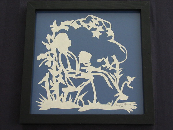 "Title: ""Mother Holding Child"" - Framed Hand Cut Parchment <br /> Size: 7x7<br /> Price:$29 Plus Tax -S&H<br /> Email Your Order: JanetLynchArt@gmail.com"