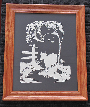"Title: "" Cow At Creek "" - Framed Hand Cut Parchment<br /> Size: 11x14<br /> Difficulty 8 of 10<br /> Price: $79 <br /> Buy This Item: <a href=""http://www.etsy.com/listing/88576612/cow-at-creek-scherenschnitte-hand-paper"">http://www.etsy.com/listing/88576612/cow-at-creek-scherenschnitte-hand-paper</a><br /> <br /> Scherenschnitte (hand paper cutting)<br /> Signed and dated by Janet Lynch framed<br /> Water Mark will not appear on your art order<br /> <br /> ~Want this as a print on a 5x7 Note Card? <a href=""http://www.etsy.com/listing/71810088/note-cards-5x7-choose-any-photo-or-paper"">http://www.etsy.com/listing/71810088/note-cards-5x7-choose-any-photo-or-paper</a><br /> <br /> ~ Want this as a print on a jewelry pendant? <a href=""http://www.etsy.com/listing/74448914/cape-hatteras-lighthouse-fine-art"">http://www.etsy.com/listing/74448914/cape-hatteras-lighthouse-fine-art</a><br /> <br /> ~ Special Custom requests welcome.....just email me and I will do my best to work with you. If you have a theme or particular interest I am sure I have a design for you......or I will design one just for you.  Email : JanetLynchArt@gmail.com<br /> <br /> ~All images are copyright protected and the exclusive property of Janet Lynch and may not be used without permission.<br /> ~Frames may vary slightly depending on available stock"