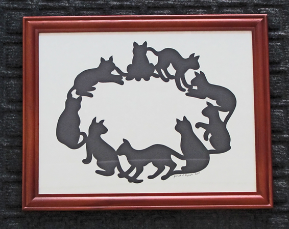 "itle: "" Cats In A Circle "" - Framed Hand Cut Parchment<br /> Size: 8.5x11<br /> Difficulty 6 of 10<br /> Price:$20 Plus Tax -S&H<br /> <br /> Buy This Item :  <a href=""http://www.etsy.com/listing/86284987/cats-in-a-circle-scherenschnitte-hand?ref=v1_other_1"">http://www.etsy.com/listing/86284987/cats-in-a-circle-scherenschnitte-hand?ref=v1_other_1</a><br /> <br /> Scherenschnitte (hand paper cutting)<br /> Signed and dated by Janet Lynch framed 8.5x11<br /> Water Mark will not appear on your art order<br /> <br /> ~Want this as a print on a 5x7 Note Card? <a href=""http://www.etsy.com/listing/71810088/note-cards-5x7-choose-any-photo-or-paper"">http://www.etsy.com/listing/71810088/note-cards-5x7-choose-any-photo-or-paper</a><br /> <br /> ~ Want this as a print on a jewelry pendant? <a href=""http://www.etsy.com/listing/74448914/cape-hatteras-lighthouse-fine-art"">http://www.etsy.com/listing/74448914/cape-hatteras-lighthouse-fine-art</a><br /> <br /> ~ Special Custom requests welcome.....just CLICK ON CONTACT AT THE BOTTOM and I will do my best to work with you. If you have a theme or particular interest I am sure I have a design for you......or I will design one just for you."