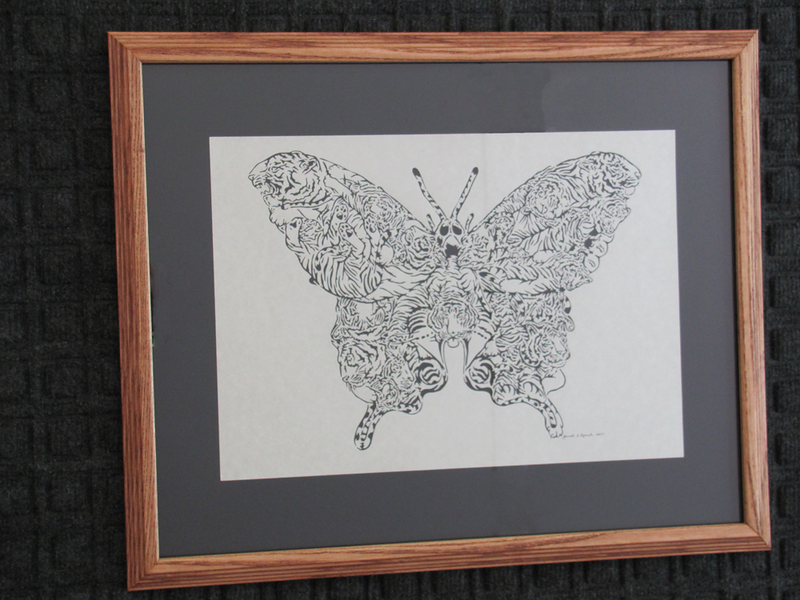 """Title: """" Tiger Swallowtail Butterfly """" - Framed Hand Cut Parchment Size: 16x20 Difficulty 10 of 10 Price: $650 Buy This Item: http://www.etsy.com/listing/88653795/tiger-swallowtail-butterfly  This is my most difficult piece to date. Just in time for that extra special gift. This piece originally was a pen and ink drawing by Don Stewart and then made into a scroll pattern by Jeff Zaffino and now I have adapted it for My Scherenschnitte Paper Cutting Art with the blessings of the artist. At first I just wanted to see if I could complete this difficult piece that includes 24 Tigers that make up the butterfly. This piece took me 27 hours over 2 years working as my eyes and hands and mind could take the small cuts.  Scherenschnitte (hand paper cutting) Signed and dated by Janet Lynch framed Water Mark will not appear on your art order  ~Want this as a print on a 5x7 Note Card? http://www.etsy.com/listing/71810088/note-cards-5x7-choose-any-photo-or-paper  ~ Want this as a print on a jewelry pendant? http://www.etsy.com/listing/74448914/cape-hatteras-lighthouse-fine-art  ~ Special Custom requests welcome.....just email me and I will do my best to work with you. If you have a theme or particular interest I am sure I have a design for you......or I will design one just for you. Email: JanetLynchArt@gmail.com  ~All images are copyright protected and the exclusive property of Janet Lynch and may not be used without permission. ~Frames may vary slightly depending on available stock"""