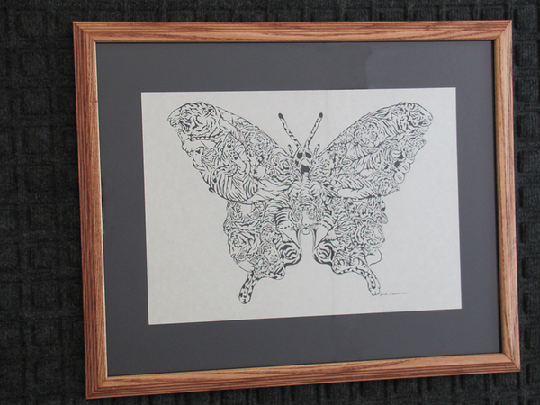 "Title: "" Tiger Swallowtail Butterfly "" - Framed Hand Cut Parchment<br /> Size: 16x20<br /> Difficulty 10 of 10<br /> Price: $650<br /> Buy This Item: <a href=""http://www.etsy.com/listing/88653795/tiger-swallowtail-butterfly"">http://www.etsy.com/listing/88653795/tiger-swallowtail-butterfly</a><br /> <br /> This is my most difficult piece to date. Just in time for that extra special gift. This piece originally was a pen and ink drawing by Don Stewart and then made into a scroll pattern by Jeff Zaffino and now I have adapted it for My Scherenschnitte Paper Cutting Art with the blessings of the artist. At first I just wanted to see if I could complete this difficult piece that includes 24 Tigers that make up the butterfly. This piece took me 27 hours over 2 years working as my eyes and hands and mind could take the small cuts.<br /> <br /> Scherenschnitte (hand paper cutting)<br /> Signed and dated by Janet Lynch framed<br /> Water Mark will not appear on your art order<br /> <br /> ~Want this as a print on a 5x7 Note Card? <a href=""http://www.etsy.com/listing/71810088/note-cards-5x7-choose-any-photo-or-paper"">http://www.etsy.com/listing/71810088/note-cards-5x7-choose-any-photo-or-paper</a><br /> <br /> ~ Want this as a print on a jewelry pendant? <a href=""http://www.etsy.com/listing/74448914/cape-hatteras-lighthouse-fine-art"">http://www.etsy.com/listing/74448914/cape-hatteras-lighthouse-fine-art</a><br /> <br /> ~ Special Custom requests welcome.....just email me and I will do my best to work with you. If you have a theme or particular interest I am sure I have a design for you......or I will design one just for you. Email: JanetLynchArt@gmail.com<br /> <br /> ~All images are copyright protected and the exclusive property of Janet Lynch and may not be used without permission.<br /> ~Frames may vary slightly depending on available stock"