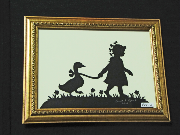 "Title: "" Girl With Goose "" - Framed Hand Cut Parchment<br /> Size: 5x7<br /> Difficulty 5 of 10<br /> Price: $15<br /> <br /> Buy This Item: <a href=""http://www.etsy.com/listing/86284627/girl-with-goose-scherenschnitte-hand"">http://www.etsy.com/listing/86284627/girl-with-goose-scherenschnitte-hand</a><br /> <br /> Scherenschnitte (hand paper cutting)<br /> Signed and dated by Janet Lynch framed 5x7<br /> Water Mark will not appear on your art order<br /> <br /> ~Want this as a print on a 5x7 Note Card? <a href=""http://www.etsy.com/listing/71810088/note-cards-5x7-choose-any-photo-or-paper"">http://www.etsy.com/listing/71810088/note-cards-5x7-choose-any-photo-or-paper</a><br /> <br /> ~ Want this as a print on a jewelry pendant? <a href=""http://www.etsy.com/listing/74448914/cape-hatteras-lighthouse-fine-art"">http://www.etsy.com/listing/74448914/cape-hatteras-lighthouse-fine-art</a><br /> <br /> ~ Special Custom requests welcome.....just CLICK CONTACT AT THE BOTTOM and I will do my best to work with you. If you have a theme or particular interest I am sure I have a design for you......or I will design one just for you."