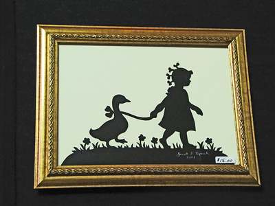 """Title: """" Girl With Goose """" - Framed Hand Cut Parchment<br /> Size: 5x7<br /> Difficulty 5 of 10<br /> Price: $15<br /> <br /> Buy This Item: <a href=""""http://www.etsy.com/listing/86284627/girl-with-goose-scherenschnitte-hand"""">http://www.etsy.com/listing/86284627/girl-with-goose-scherenschnitte-hand</a><br /> <br /> Scherenschnitte (hand paper cutting)<br /> Signed and dated by Janet Lynch framed 5x7<br /> Water Mark will not appear on your art order<br /> <br /> ~Want this as a print on a 5x7 Note Card? <a href=""""http://www.etsy.com/listing/71810088/note-cards-5x7-choose-any-photo-or-paper"""">http://www.etsy.com/listing/71810088/note-cards-5x7-choose-any-photo-or-paper</a><br /> <br /> ~ Want this as a print on a jewelry pendant? <a href=""""http://www.etsy.com/listing/74448914/cape-hatteras-lighthouse-fine-art"""">http://www.etsy.com/listing/74448914/cape-hatteras-lighthouse-fine-art</a><br /> <br /> ~ Special Custom requests welcome.....just CLICK CONTACT AT THE BOTTOM and I will do my best to work with you. If you have a theme or particular interest I am sure I have a design for you......or I will design one just for you."""