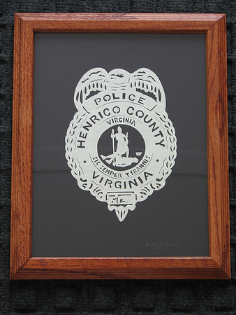 """Title: """"Policeman's Badge"""" - Hand Cut Parchment - By Janet Lynch<br /> Size: 8x10<br /> Price:$79 Plus Tax -S&H<br /> Email Janet Lynch Your Order: ArtGalleryRiverRd@gmail.com"""