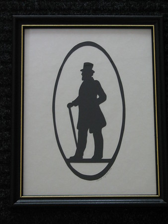 """Title: """"Victorian Silhouette-Gentleman"""" -Framed Hand Cut Black Paper <br /> Size: 8.5x11<br /> Price: Price: $29 - or- $49 for the set of 2 <br /> Email Your Order: JanetLynchArt@gmail.com"""