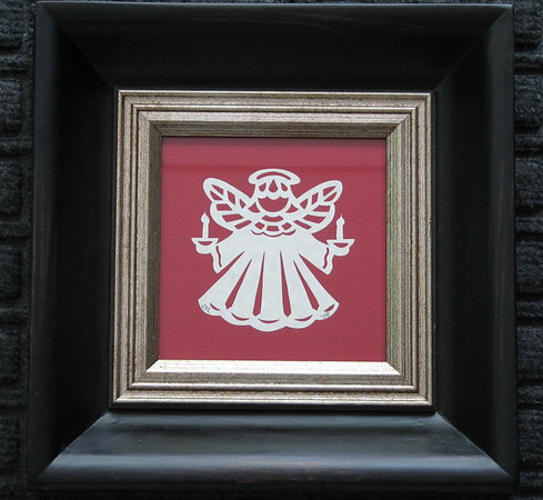 "Title: ""Angel With Two Candles"" -Framed Hand Cut Parchment  <br /> Size: 5x5<br /> Price: $25 Plus Tax -S&H<br /> Email Your Order: JanetLynchArt@gmail.com"