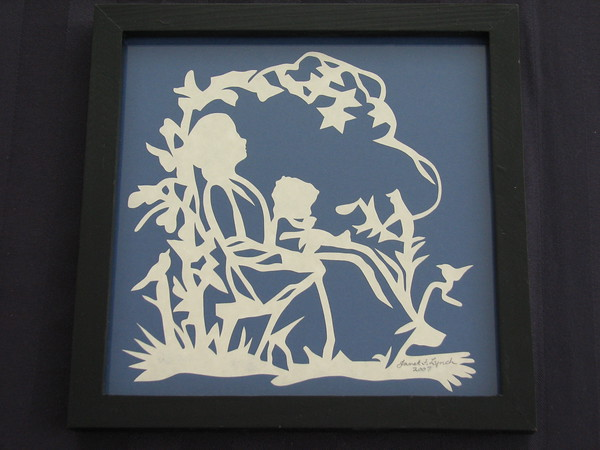 """Title: """"Mother Holding Child"""" - Framed Hand Cut Parchment <br /> Size: 7x7<br /> Price:$29 Plus Tax -S&H<br /> Email Your Order: JanetLynchArt@gmail.com"""