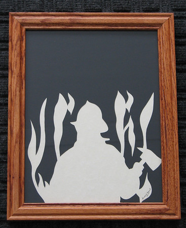 "Title: ""Fire Fighter"" - Framed Hand Cut Parchment <br /> Size: 8.5x11<br /> Price:$29 Plus Tax -S&H<br /> Email Your Order: JanetLynchArt@gmail.com"