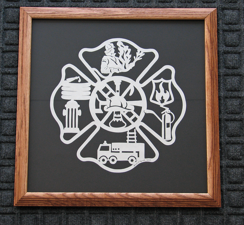 """Title: """"Fireman's Plaque """" -Framed Hand Cut Parchment   Size: 14x14 Square Difficulty 6 of 10 Price: $79 Plus Tax -S&H  Buy This Item: http://www.etsy.com/listing/43544602/firemans-plaque-scherenschnitte-hand  Fireman's Plaque -Scherenschnitte - Hand Paper Cutting Art signed dated by Janet Lynch framed 14x14 - FREE U.S.Ship with another item.  Scherenschnitte (hand paper cutting) Signed and dated by Janet Lynch framed 14x14  Water Mark will not appear on your art order  ~This paper cutting and all Scherenschnitte Art listed in my shop available as a beautiful print NoteCard. $3.95 ea or $2.95 ea if you order 10 mix or match http://www.etsy.com/listing/71810088/note-cards-5x7-choose-any-photo-or-paper  ~THIS ITEM SHIPS FREE IN US AND CANADA IF SHIPPED WITH ANY OTHER PURCHASE  ~Have a special size or request? Just CLICK ON CONTACT AT THE BOTTOM and we'll see what we can work out.  All images are copyright protected and the exclusive property of Janet Lynch and may not be used without permission.  JanetLynchArt@gmail.com"""