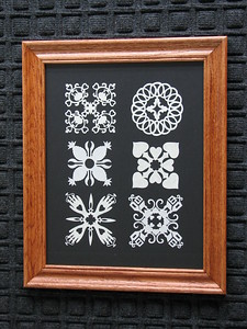 "Title: ""Quilt Applique Collection"" - Framed  Hand Cut Quilt Patterns Size: 11x14 Difficulty 8 of 10   Buy This Item: http://www.etsy.com/listing/42153701/quilt-applique-collection-framed-hand  Scherenschnitte (hand paper cutting) Signed and dated by Janet Lynch framed 11x14 Water Mark will not appear on your art order  ~This paper cutting and all Scherenschnitte Art listed in my shop available as a beautiful print NoteCard. $3.95 ea or $2.95 ea if you order 10 mix or match http://www.etsy.com/your/item/edit/71810088?step=publish  ~THIS ITEM SHIPS FREE IN US AND CANADA IF SHIPPED WITH ANY OTHER PURCHASE  ~Have a special size or request? Just CLICK ON CONTACT AT THE BOTTOM and we'll see what we can work out!  All images are copyright protected and the exclusive property of Dave Lynch and may not be used without permission. JanetLynchArt@gmail.com"