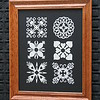 "Title: ""Quilt Applique Collection"" - Framed  Hand Cut Quilt Patterns<br /> Size: 11x14<br /> Difficulty 8 of 10<br /> <br /> <br /> Buy This Item: <a href=""http://www.etsy.com/listing/42153701/quilt-applique-collection-framed-hand"">http://www.etsy.com/listing/42153701/quilt-applique-collection-framed-hand</a><br /> <br /> Scherenschnitte (hand paper cutting)<br /> Signed and dated by Janet Lynch framed 11x14<br /> Water Mark will not appear on your art order<br /> <br /> ~This paper cutting and all Scherenschnitte Art listed in my shop available as a beautiful print NoteCard. $3.95 ea or $2.95 ea if you order 10 mix or match <a href=""http://www.etsy.com/your/item/edit/71810088?step=publish"">http://www.etsy.com/your/item/edit/71810088?step=publish</a><br /> <br /> ~THIS ITEM SHIPS FREE IN US AND CANADA IF SHIPPED WITH ANY OTHER PURCHASE<br /> <br /> ~Have a special size or request? Just CLICK ON CONTACT AT THE BOTTOM and we'll see what we can work out!<br /> <br /> All images are copyright protected and the exclusive property of Dave Lynch and may not be used without permission. JanetLynchArt@gmail.com"